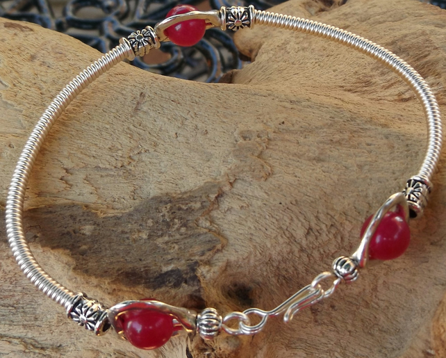 "7.5"" silver plated bracelet with silver plated gizmo wire cover with rose jade"