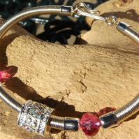 silver plated wire bracelet with pink crystals and rhinestone charm