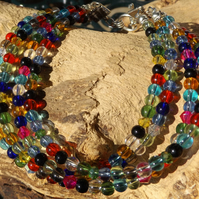 Multi coloured glass bead and crystal bracelet with toggle clasp