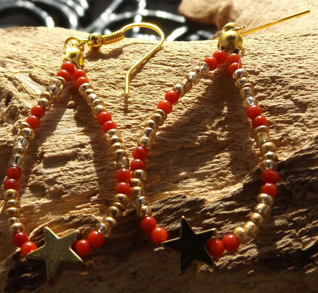 Gold plated red coral and seed beaded and Hematite gold star earrings