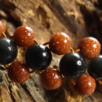 Goldstone and black obsidian beaded bracelet