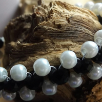 white glass pearl with black crystal bracelet
