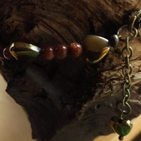 Goldstone and gold hematite heart bracelet