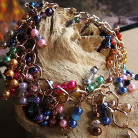 Rose gold plated multi coloured charm and crystal bracelet