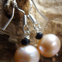 Sterling silver peach pearl earrings with black spinel
