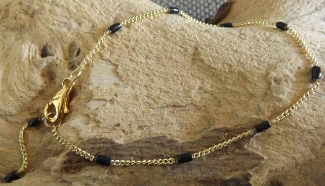 Black enamel gold chain bracelet