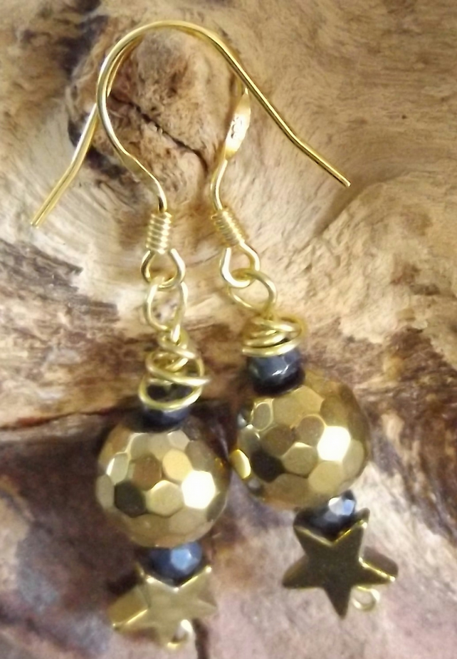 Hematite gold bead and star with coated spinel earrings