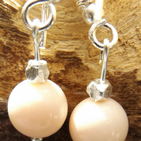 Peach shell pearl earrings