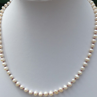 "White freshwater cultured pearl 18"" necklace with rubies"