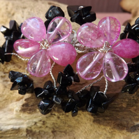 Pink quartzite flower brooch with black onyx