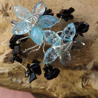 Blue quartzite flower brooch with black onyx