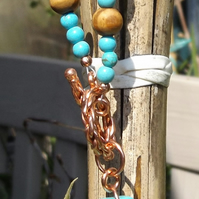 Turquoise magnesite and burly wood necklace with magnesite cross pendant