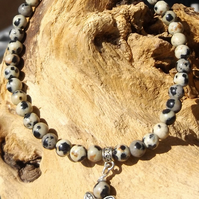 Dalmatian Jasper beaded stretch bracelet with silver butterfly charm