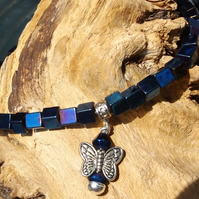 Blue hematite stretch bracelet with butterfly charm