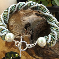 Bugle twist seeded beaded bracelet