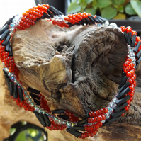 Black red and white twisted seed beaded bracelet