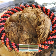 Red and black kumihimo bracelet