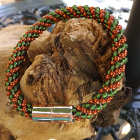 Kumihimo bracelet with Green and bronze seed beads
