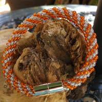 Orange and silver kumihimo bracelet