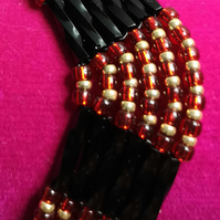 Black gold and red seed beaded bracelet