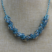 "Blue silver and Gold seed beaded spiral 18"" necklace"