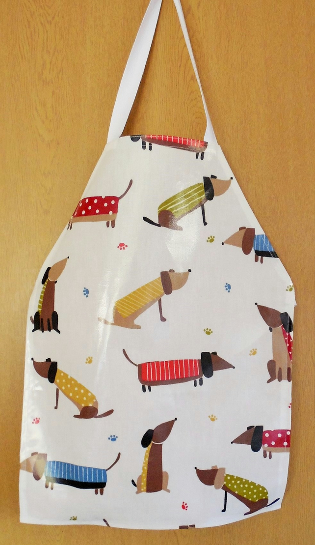 Childs apron . John Lewis sausage dog pvc fabric.