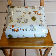 Toddler booster bean cushion. Woodland fox oilcloth, with Ties.