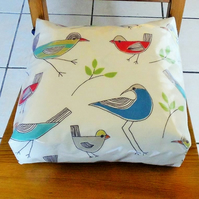 Toddler booster bean cushion. John Lewis stick birds oilcloth,with Ties.