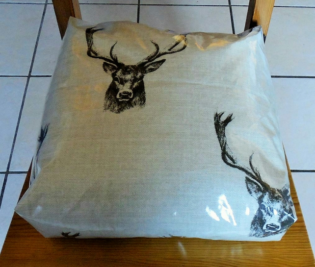 Toddler booster bean cushion. Stag oilcloth,with Ties.