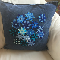 Denim cushion with flower details