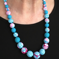 Turquoise and pink beaded necklace