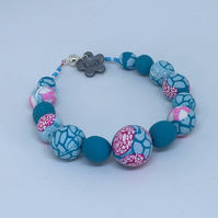 Turquoise,pink and white beaded bracelet