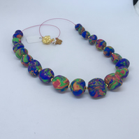 Rainbow bright handmade bead necklace with gold accent