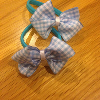 Set of two blue gingham ribbon school hair bows on snag free hair band