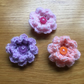 Set of three crochet flower hair clips with button centres