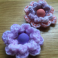 Set of two hand crochet flower hair clips purple and orange