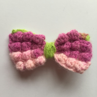 Green, pink and purple crochet hair bow