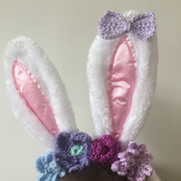 Easter bunny ears with crochet flowers in purples
