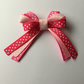 Polka dot pink ribbon hair bow