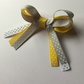 Polka dot ribbon hair bow yellow
