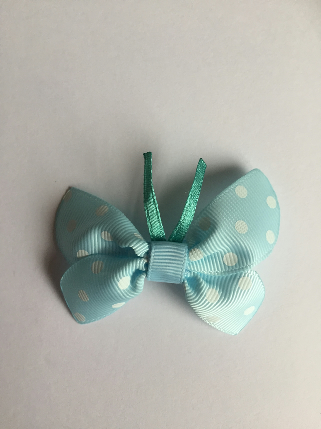 Pastel blue butterfly hair clip