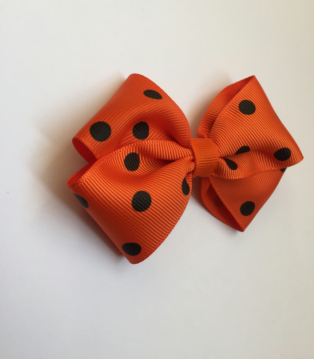 Orange polka dot hair bow