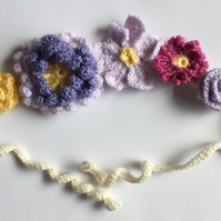 Crochet flower headband in purples