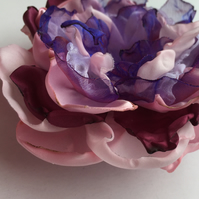 Pink and purple fabric hair flower
