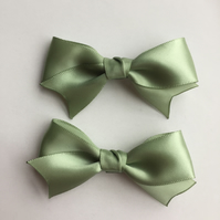 Set of two sage green satin hair bows