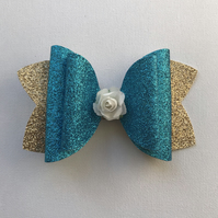 Glitter flower hair bow blue and gold