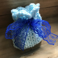 Blue crochet gift bag with royal blue lace bow