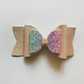 Glitter hair bow in pastel pink and rainbow