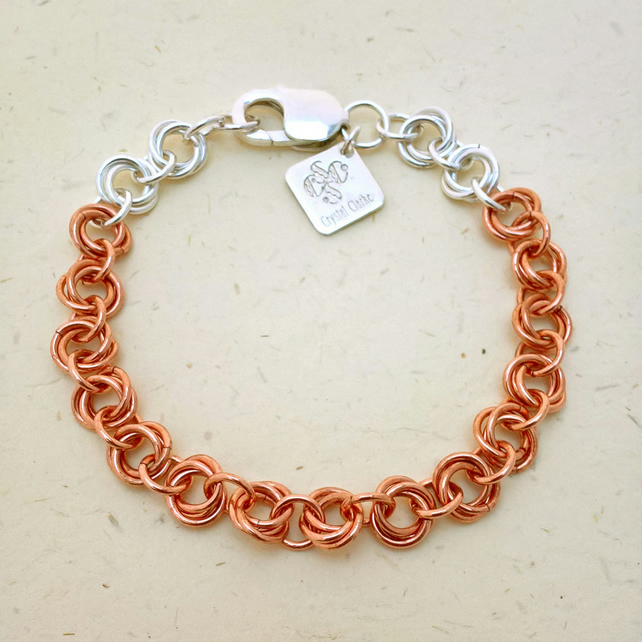 Copper and sterling silver chainmaille bracelet in a lovely mobius flower weave