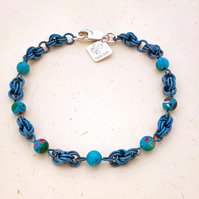 Seaside inspired casillica beads and titanium bracelet.